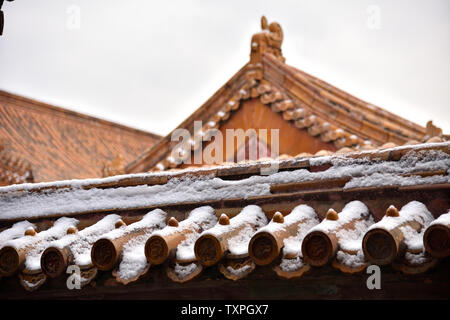 After the snow, the Forbidden City, after a snow in Beijing, the Forbidden City became white, and the roofs, railings, corner towers and city walls showed the stability of the atmosphere through the wind and frost. - Stock Photo