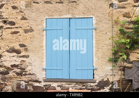 Isolated blue shutters of a window in the countryside (Moselkern, Germany, Europe) - Stock Photo