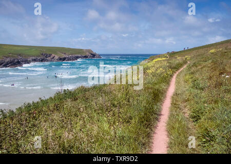 The South West Coast Path on the coast of Polly Porth Joke in Newquay in Cornwall. - Stock Photo