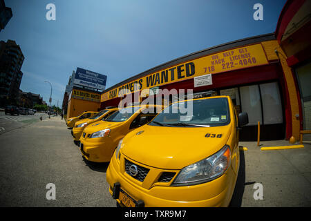 Unused taxis, without drivers, in a taxicab garage in the Park Slope neighborhood of Brooklyn in New York on Sunday, June 23, 2019. With the growth of ride sharing apps such as Lyft and Uber people are abandoning taxis as their preferred form of transportation causing the inflated prices of medallions to plummet. (© Richard B. Levine) - Stock Photo