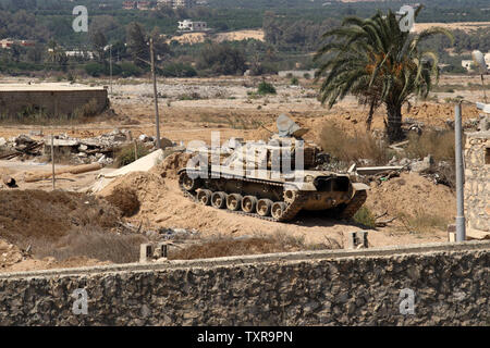 An Egyptian tank is seen from the border of southern Gaza  with Egypt September 18, 2015. According to Palestinian witnesses, Egyptian forces pumped water from the Mediterranean Sea through pipes to destroy smuggling tunnels dug beneath the Gaza-Egypt border. Photo by Ismael Mohamad/UPI - Stock Photo