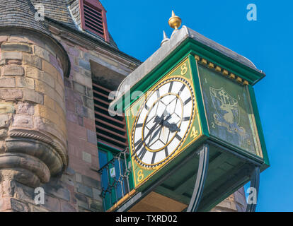 Closeup of Canongate tolbooth clock - part of a historic landmark, built in 1591 as the centre of administration and justice. Edinburgh, Scotland, UK. - Stock Photo