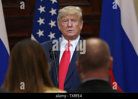 U.S. President Donald Trump arrives at a joint press conference at the Presidential Palace in Helsinki, Finland on July 16, 2018. Prior to the conference, President Trump met with Russian President Vladimir Putin to discuss a variety of subjects including election meddling, the war in Syria and the North Korean threat.   Photo by David Silpa/UPI - Stock Photo