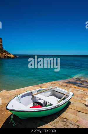 Green fishing boat, Burgau harbour, Algarve, Portugal - Stock Photo