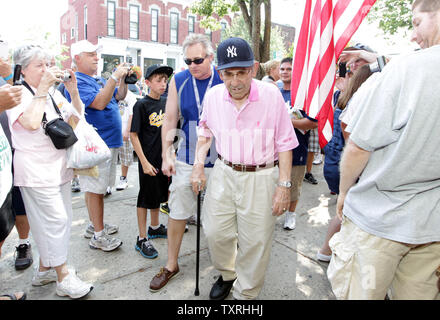 National Baseball Hall of Fame member Yogi Berra makes his way through the crowd on Main Street as he prepares to sign at a card show in Cooperstown, New York on July 21, 2011. The town is preparing to welcome the Class of 2011 on July 24, 2011. UPI/Bill Greenblatt - Stock Photo