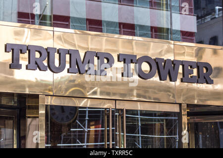 NEW YORK, USA - MAY 15, 2019: Low angle of the gold facade of Trump Tower, the skyscraper home to Trump Organization political headquarters, luxury - Stock Photo