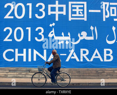 Chinese walk to the opening of the China-Arab State Expo beijing held in Yinchuan, the capital of China's northwestern Ningxia Hui Autonomous Region on September 15, 2013.  Yinchuan, a predominantly Muslim city and a major crossroad between China and her Muslim neighbors, is being developed as the capital of China-Arab bilateral trade.    UPI/Stephen Shaver - Stock Photo