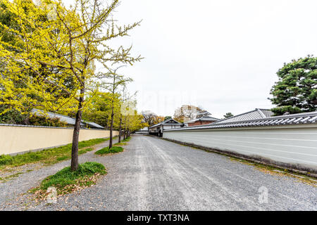 Kyoto, Japan city street wide angle view during day wall exterior way to entrance of Imperial Palace with nobody in garden - Stock Photo