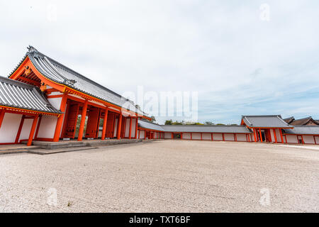 Kyoto, Japan - April 17, 2019: Wide angle of red gate exterior and courtyard in Imperial Palace with garden road Stock Photo
