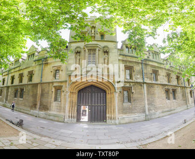 Entrance and exterior facade of St John's college, Oxford university, along St Giles street on a sunny summer morning.