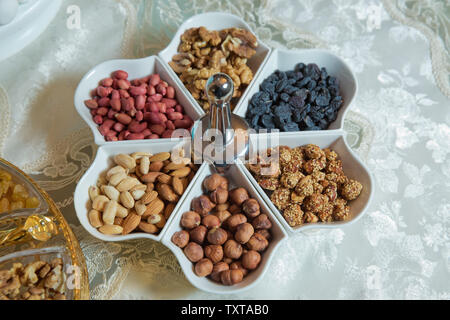 The almond, nuts, arachis, raisins, nuts and walnuts are in the bowl. Mixed desserts - Stock Photo