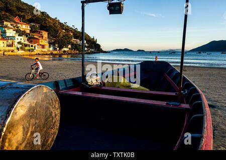 Fishing boat on the sand at Pantano do Sul Beach. Florianopolis, Santa Catarina, Brazil. - Stock Photo