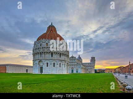 The Baptistery in the foreground, the Duomo and the leaning tower in the background, Pisa, Italy - Stock Photo