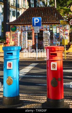 Red and blue postboxes in front of the Municiple garden Funchal in the Old Town, Madeira, Portugal, European Union - Stock Photo