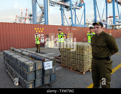 An Israeli soldier stands by a display of Iranian supplied arms seized by  Israeli commandos at the Ashdod Port on November 4, 2009. The Israeli Navy intercepted the Antiqua-flagged Francop vessel in the Mediterranean Sea carrying hundreds of tons of Iranian supplied arms bound for Syria. UPI/Debbie Hill - Stock Photo
