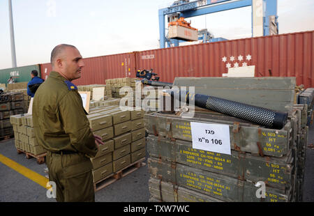 An Israeli officer looks at Iranian supplied arms seized by  Israeli commandos, displayed at the Ashdod Port on November 4, 2009. The Israeli Navy intercepted the Antiqua-flagged Francop vessel in the Mediterranean Sea carrying hundreds of tons of Iranian supplied arms bound for Syria. UPI/Debbie Hill - Stock Photo