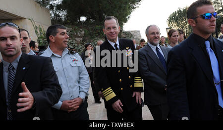 Chairman of the U.S. Joint Chiefs of Staff Admiral Michael Mullen (C) and Israeli IDF Chief of General Staff, Lt. General Gabi Ashkenazi (2nd L) walk behind security guards at the end of a visit to the Yad Vashem Holocaust History Museum in Jerusalem, February 15, 2010.  UPI/Debbie Hill - Stock Photo