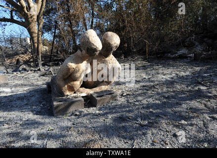 A sculpture burned by wildfires stands in Ein Hod, an artist's village, in the Carmel Mountains in northern Israel. More than 17,000 residents have been evacuated and 42 killed in the worse forest fire in the history of Israel. UPI/Debbie Hill - Stock Photo