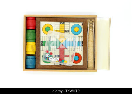 Ludo (board game) miniature,  isolated on white background, close-up - Stock Photo