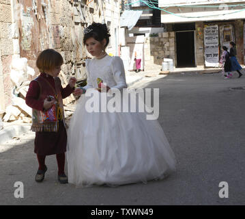 An Ultra-Orthodox Jewish girl wears a wedding dress on the Purim holiday in Mea Shearim in Jerusalem, Israel, March 6, 2015. The festival of Purim commemorates the rescue of the Jews from genocide in ancient Persia. Photo by Debbie Hill/UPI - Stock Photo