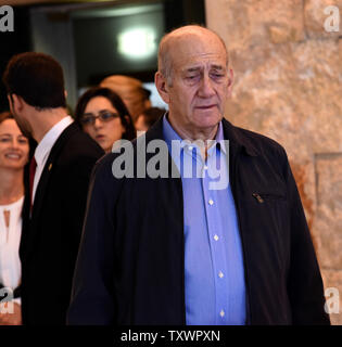 Former Israeli Prime Minister Ehud Olmert leaves the courtroom of the Supreme Court after the court gave the final verdict in the Holyland corruption case in Jerusalem, Israel, January 29, 2015. Olmert's sentence was reduced from six years to 18 months in prison for accepting bribes. His sentence will begin on February 15.  Photo by Debbie Hill/ UPI - Stock Photo
