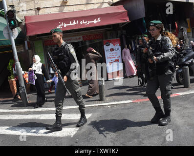 Israeli border police patrol outside the Old City in East Jerusalem, September 22, 2016. Israeli soldiers arrested 23 Palestinians early Thursday in raids in several East Jerusalem neighborhoods in a search for arms and suspected offenders in the new wave of stabbing terror attacks.  The Israeli Defense establishment expects a rise of attacks ahead of the upcoming Jewish High Holy Days in early October.  Photo by Debbie Hill/ UPI - Stock Photo