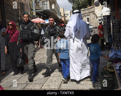 Israeli border police patrol in the Muslim Quarter of the Old City of Jerusalem, September 22, 2016. Israeli soldiers arrested 23 Palestinians early Thursday in raids in several East Jerusalem neighborhoods in a search for arms and suspected offenders in the new wave of stabbing terror attacks.  The Israeli Defense establishment expects a rise of attacks ahead of the upcoming Jewish High Holy Days in early October.  Photo by Debbie Hill/ UPI - Stock Photo