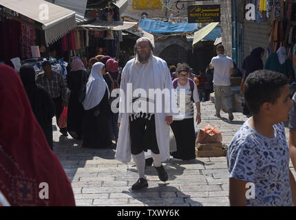 An Ultra-Orthodox Jew wears a white robe on Rosh HaShanah, the Jewish New Year, in the Old City of Jerusalem, September 21, 2017. Muslims are also observing the Islamic New Year today. Both religions follow the lunar calendar. Photo by Debbie Hill/UPI - Stock Photo