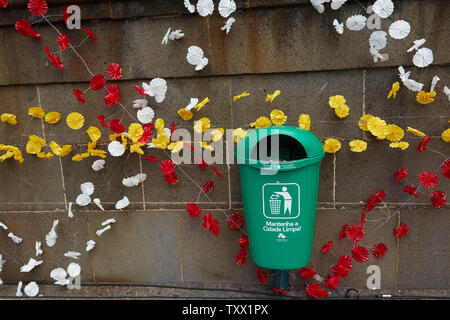 Green waste bin and flowers for tidy streets, in the Old Town Funchal, Madeira, Portugal, - Stock Photo