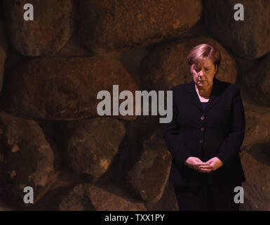German Chancellor Angela Merkel takes part in a memorial ceremony in the Hall of Remembrance in the Yad Vashem Holocaust Museum in Jerusalem, October 4, 2018.   Photo by Debbie Hill/UPI - Stock Photo