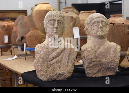 The Israel Antiquities Authority presents two late Roman period busts (3rd - 4th CE), that were recently discovered by a woman on a walk in Beth Shean in northern Israel, in their laboratories in Jerusalem, December 30, 2018.  Scholars say that the 1,7000 year old  limestone busts were placed at the entrance of burial caves and were probably the images of the deceased. Photo by Debbie Hill  /UPI - Stock Photo