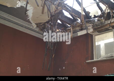 fire damaged house - Stock Photo