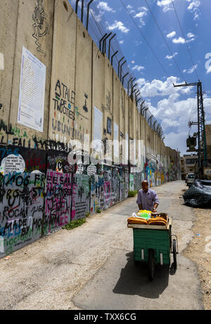 Concrete security wall between Israel and the West Bank in Bethlehem - Stock Photo