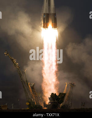 The Russian Soyuz TMA-19M rocket is launched with Expedition 46 Soyuz Commander Yuri Malenchenko of the Russian Federal Space Agency, Flight Engineer Tim Kopra of NASA, and Flight Engineer Tim Peake of the European Space Agency (ESA) on Tuesday, December 15, 2015 at the Baikonur Cosmodrome in Kazakhstan.  Malenchenko, Kopra, and Peake will spend the next six months living and working aboard the International Space Station.   NASA Photo by Joel Kowsky/UPI - Stock Photo