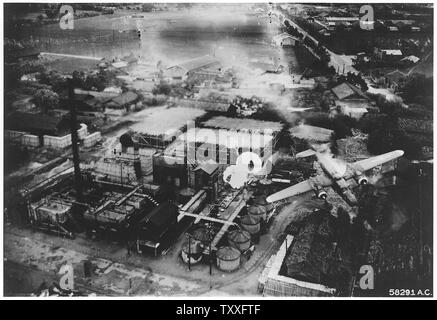 Bombing campaign. Southeast Asia & the Pacific; Scope and content:  Spectacular crash at Byoritsu oil refinery, Formosa, was photographed by a B-25 of the 5th Air Force's 345th Bomb Group on 26 May 1945. Just as it released its string of parafrags B-25 NO. 192 was hit by flak from a camouflaged battery and trails smoke. A gaping hole is visible on the piolot's side. General notes:  The aircraft visible is the North American B-25J-10-NC Mitchell (s/n 43-36192) Jaunty Jo. Crew: 2/Lt Robert J. Knauf Pilot, 2/Lt Martin H. Mulner Jr. Co-Pilot, 1/Lt Lloyd E. Bodell Navigator, Cpl Harold O. Montvill - Stock Photo