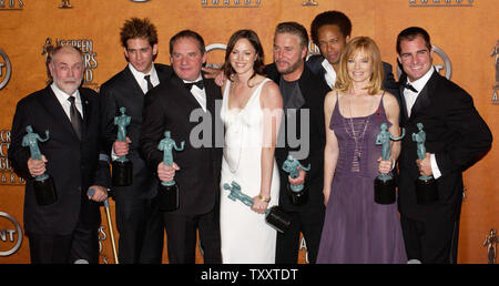 Cast members of the television series 'CSI Crime Scene Investigation,' Robert David Hall, Eric Szmanda, Paul Guilfoyle, Jorja Fox, William Peterson ,Gary Dourdan, Marg Helgenberger and George Eads, hold the Actor statuettes they won for outstanding performance by an ensemble cast in television drama series during the 11th annual Screen Actors Guild Awards at the Shrine Auditorium in Los Angeles February 5, 2005.    UPI Photo/Jim Ruymen) - Stock Photo