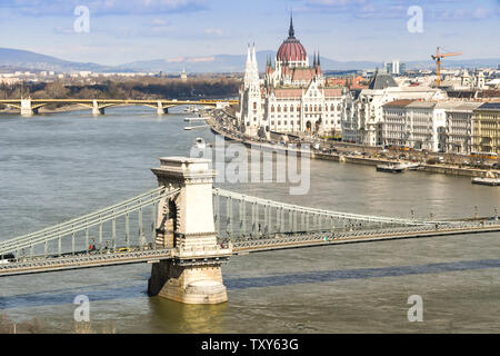 BUDAPEST, HUNGARY - MARCH 2018: The River Danube and the Chain Bridge in Budapest with the Parliament Building in the background. - Stock Photo