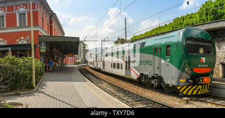 COMO, ITALY - JUNE 2019: Panoramic view of a modern electric train in the town centre station of North Lake Como - Stock Photo