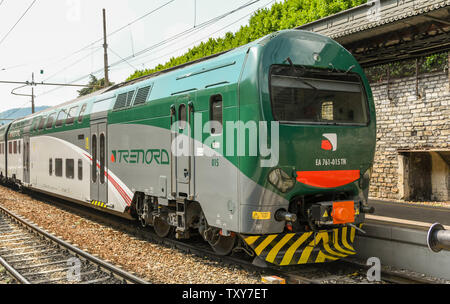 COMO, ITALY - JUNE 2019: Modern electric train in the town centre station of North Lake Como - Stock Photo