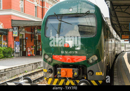 COMO, ITALY - JUNE 2019: Head on view of a modern electric train in the town centre station of North Lake Como - Stock Photo
