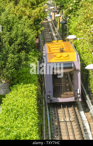 COMO, ITALY - JUNE 2019: Carriage on the funicular railway in Como which takes visitors up the steep mountain for views of the town and Lake Como. - Stock Photo