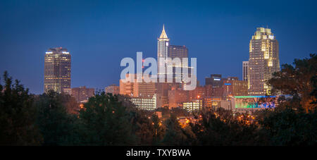 Skyline of Raleigh, North Carolina at dusk. - Stock Photo
