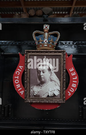 Picture of Queen Victoria mounted on the back of the wood tender of CPR locomotive No 374 which arrived in Vancouver with passengers from Montreal in - Stock Photo