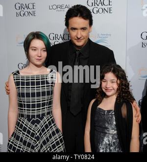 Shelan O'Keefe, John Cusack and Gracie Bednarczyk (L-R), cast members in the motion picture Iraq drama 'Grace Is Gone,' attend the premiere of the film at the Academy of Motion Picture Arts and Sciences in Beverly Hills, California on November 28, 2007. (UPI Photo/Jim Ruymen) - Stock Photo
