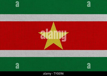 Suriname fabric flag. Patriotic background. National flag of Suriname - Stock Photo