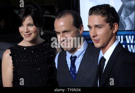 D.J. Caruso (C), who directed the motion picture thriller 'Eagle Eye', attends the premiere of the film with cast members Michelle Monaghan (L) and Shia LaBeouf (R) at Grauman's Chinese Theatre in the Hollywood section of Los Angeles on September 16, 2008.   (UPI Photo/Jim Ruymen) - Stock Photo