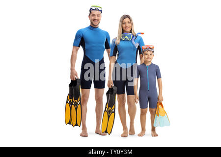 Full length portrait of a family in wetsuits, holding diving flippers and posing isolated on white background - Stock Photo