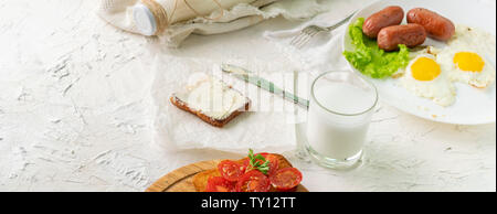 morning meal concept, table with milk with eggs and nutritious sandwich - Stock Photo