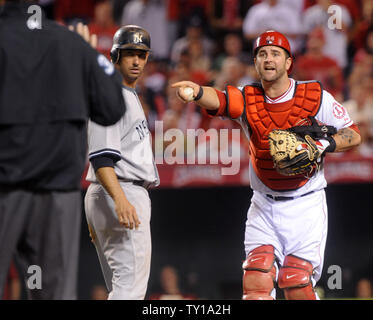Los Angeles Angles of Anaheim catcher Mike Napoli yells at the umpire after disagreeing with a call, as New York Yankees Jorge Posada (L) watches, during the fifth inning in Game 4 of the American League Championship Series (ALCS) in Anaheim, California on October 20, 2009.     UPI/Jim Ruymen - Stock Photo