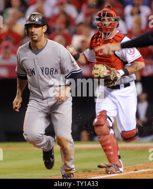 Los Angeles Angles of Anaheim catcher Mike Napoli runs down New York Yankees Jorge Posada for the out during the fifth inning in Game 4 of the American League Championship Series (ALCS) in Anaheim, California on October 20, 2009.     UPI/Jim Ruymen - Stock Photo